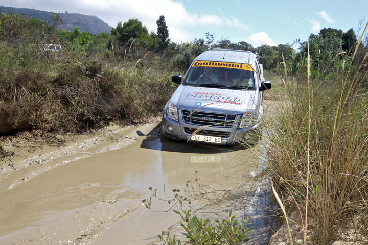 Isuzu pickup mud obstacle